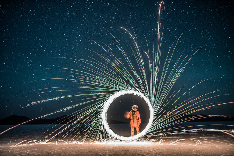 Circular spark play made by man in jump suit