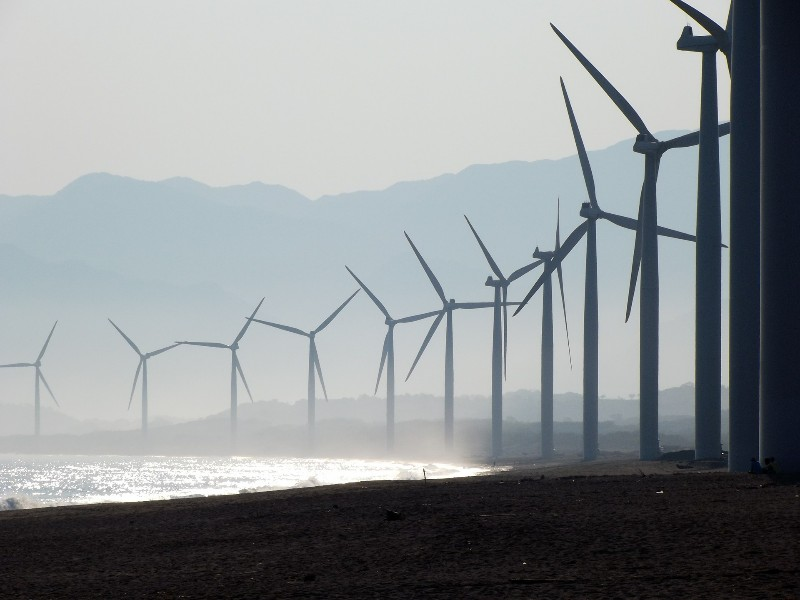 Green Energy Wind mills facing the sea