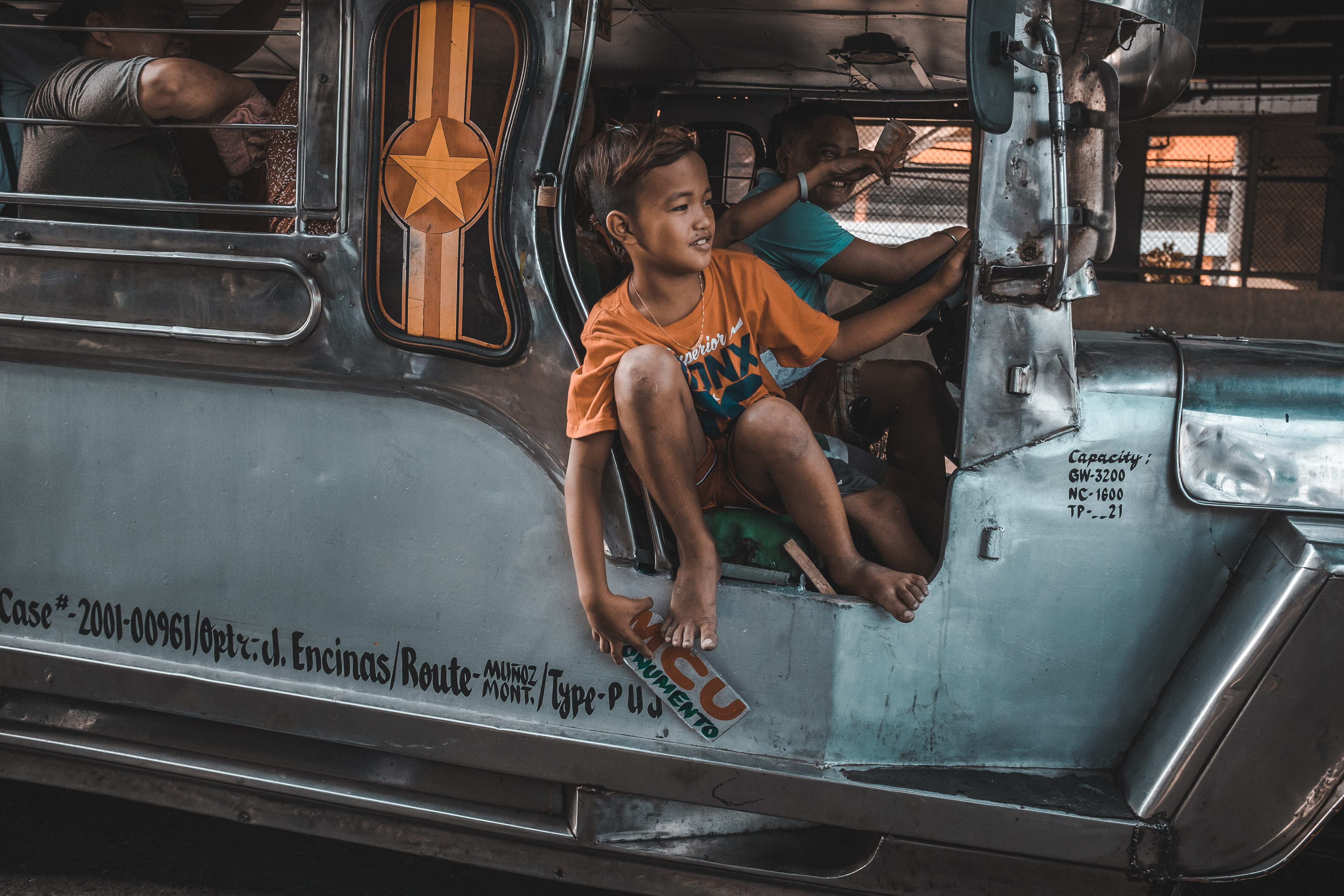 Kid calling riders to Jeepney