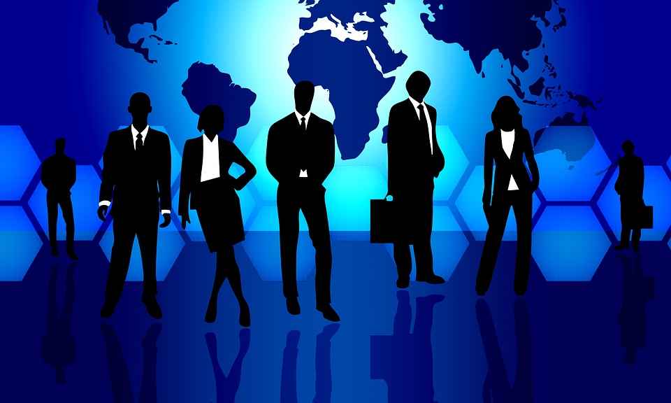 Silhouettes of Professionals with world map background