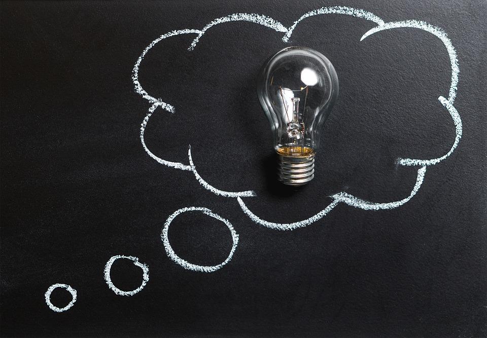Light bulb in a black board