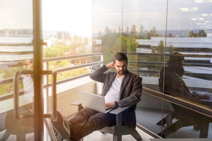 man working in balcony