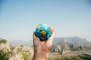 lifting globe in hand