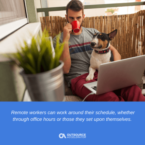 a man drinking a coffee with a dog infront of the laptop