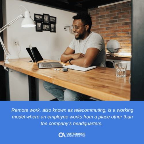 a man in front of the laptop doing remote work