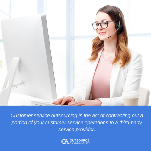 A woman in front of the computer as part of customer service outsourcing job.